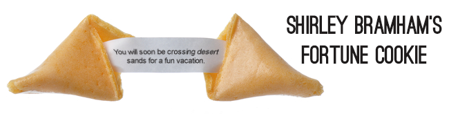 Shirley's fortune cookie foretells sand vacation